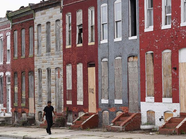 Boarded up houses in east Baltimore where communities have been ravaged by gangs, guns, drugs and racial segregation. Picture: AFP PHOTO / MANDEL NGAN