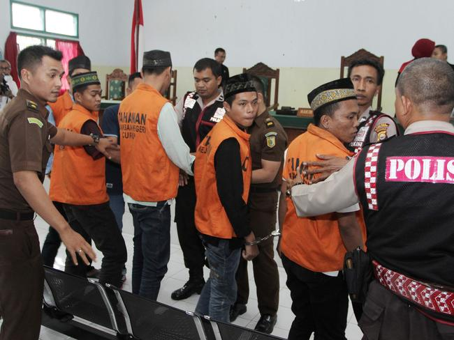 Indonesian President Joko Widodo introduced tough punishments for child sex offenders after the fatal gang-rape of a schoolgirl in April. Pictured are some of the men and boys jailed over the brutal attack. Picture: AFP/Diva Marha