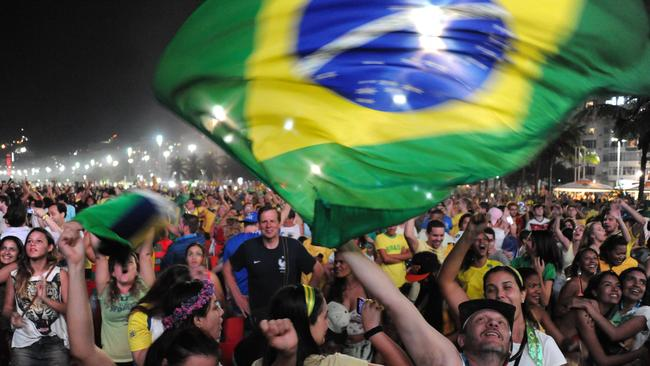 Brazilian fans celebrate during the Fan Fest at Copacabana beach in Rio de Janeiro.