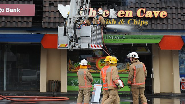 Fires outside popular fast-food shop the Chicken Cave, which was one of seven Fulham Gardens businesses wrecked by a huge fire. Picture: Mark Brake