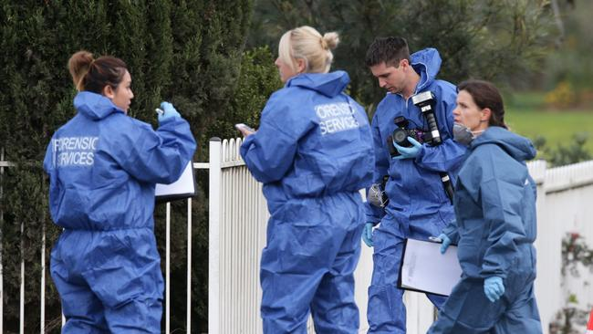 Forensic investigators at scene of fatal home invasion at home on Elizabeth Drive, Badgerys Creek. Picture: Cameron Richardson