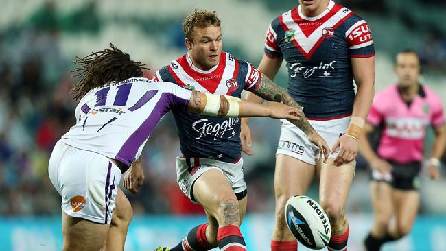 Jake Friend chips through for a Roosters try.