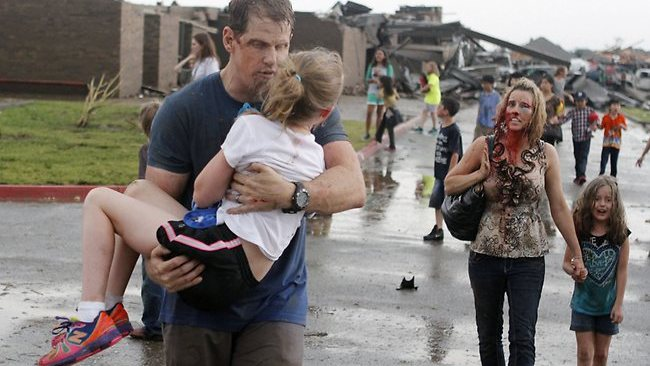 Teachers carry children away from Briarwood Elementary School after a monstrous tornado roared through the Oklahoma City suburbs. Photo: AP/The Oklahoman, Paul Hellstern