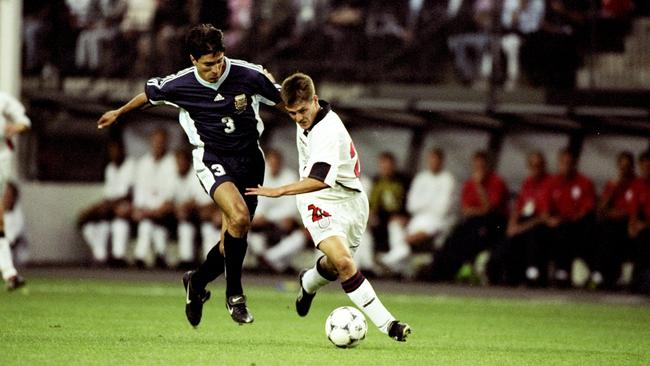 30 Jun 1998: Michael Owen of England shrugs off Jose Chamot of Argentina.