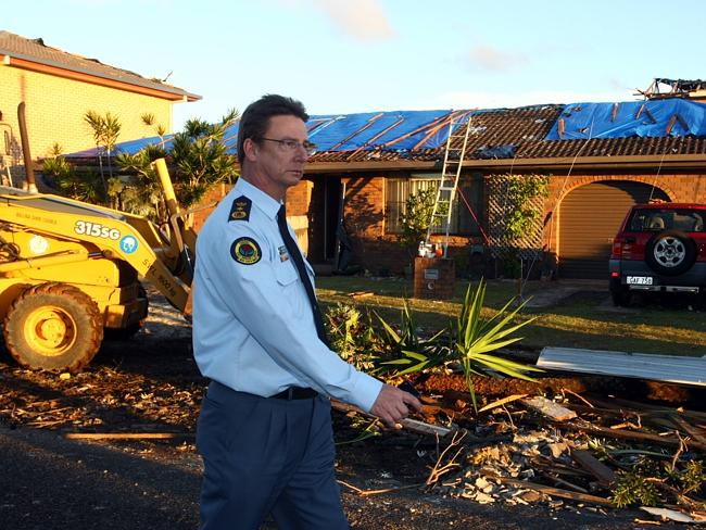 New South Wales Commissioner Murray Kear inspects the damage after a mini tornado hit Lennox Head in northern NSW.