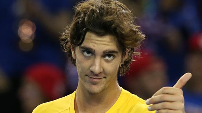 Thanasi Kokkinakis of Australia celebrates his victory over Dan Evens of Great Britain