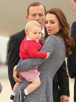 Australian Prime Minister Tony Abbott looks on as Catherine, Duchess of Cambridge holds Prince George of Cambridge as they leave Fairbairne Airbase to head back to the UK after finishing their Royal Visit. Picture: Getty