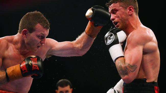 Jeff Horn (L) and Gary Corcoran (R) fight during their World Boxing Organisation welterweight title bout at Brisbane Convention Centre in Brisbane on December 13. Picture: Patrick Hamilton