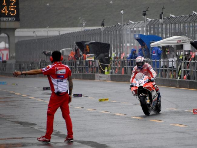 Ducati rider Andrea Dovizioso returns to his pit at the Motegi circuit.