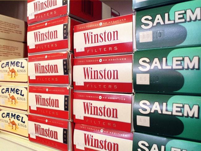 Winston, Camel and Salem cigarettes, products of the RJ Reynolds Tobacco division, are displayed on a store shelf in Dallas.
