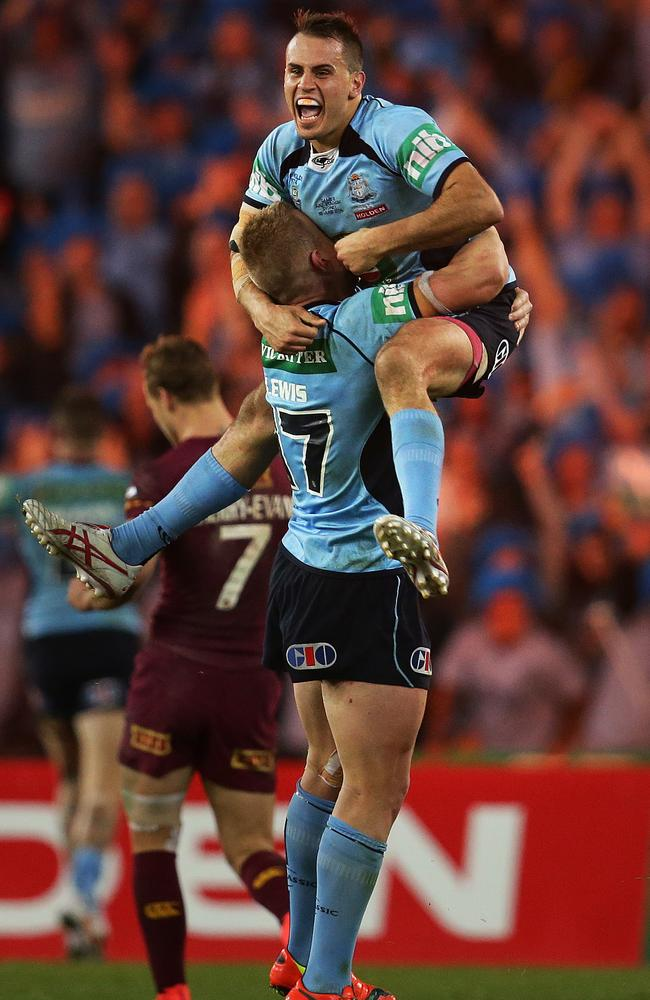 NSW's Josh Reynolds celebrates victory for the Blues with Luke Lewis during game two of State of Origin.