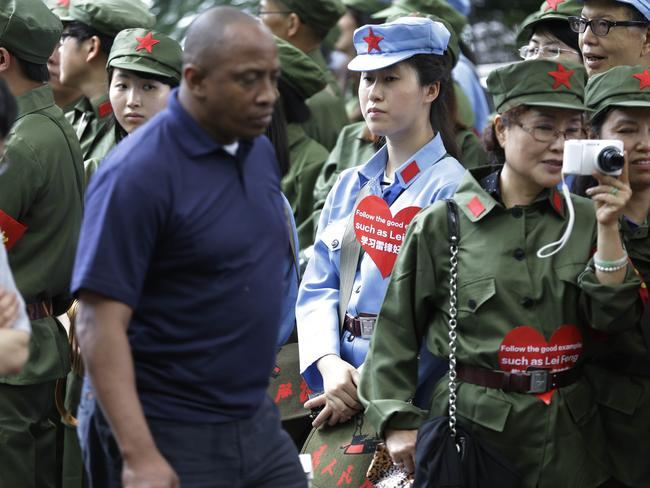Volunteer workers wore uniforms similar to those worn by the Chinese People's Liberation Army. Pic: Seth Wenig.