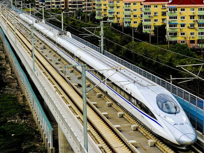 Transport of the future … A Chinese high-speed train leaves the station in Shanghai.