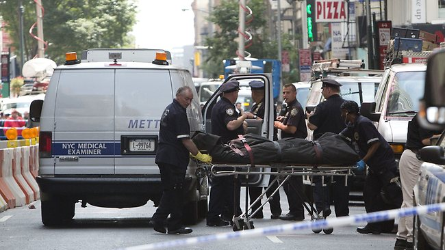 NEW YORK - AUGUST 24: The body of a shooting victim is wheeled to a medical examiner's van on West 33rd St. after being killed by 58-year-old Jeffery Johnson near the Empire State Building August 24, 2012 in New York City. Police said Johnson shot and killed a 41-year-old former co-worker of Hazan Imports during an altercation at 10 W. 33rd St. with a .45 caliber handgun. At least eight other people were wounded, at least some according to police by the New York City Police officers firing at the suspected shooter, and were taken to local hospitals to be treated for what New York City Mayor Mike Bloomberg described as non-life threatening injures. Andrew Kelly/Getty Images/AFP== FOR NEWSPAPERS, INTERNET, TELCOS & TELEVISION USE ONLY ==