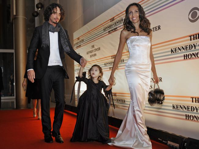 Singer Chris Cornell, left, his daughter Toni and wife Vicky, arrive for the Kennedy Centre Honours in Washington in December 2008. Picture: AP Photo/Jacquelyn Martin