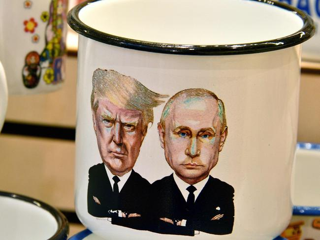 A tin mug depicting Russian President Vladimir Putin and US President Donald Trump sits on display in Moscow ahead of their July meeting. Picture: Mladen Antonov. AFP