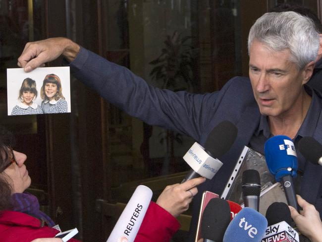 Heartbreaking ... Anthony Foster shows reporters the photo of his two daughters,who were both abused by the same priest and one of them later committed suicide. Picture: AP Photo/Riccardo De Luca