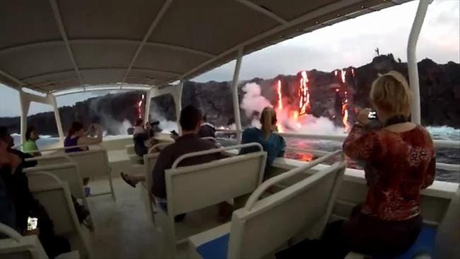 Lava waterfalls: spectacular vision of volcanic lava flowing into the ocean off Hawaii. Photo: Lava Ocean Tours