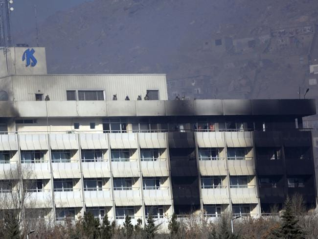 Afghan security personnel are seen at the roof of Intercontinental Hotel after an attack in Kabul, Afghanistan. Picture: AP