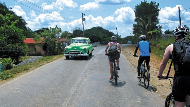 Why not experience Cuba's culture by bike? Image: Intrepid Travel.