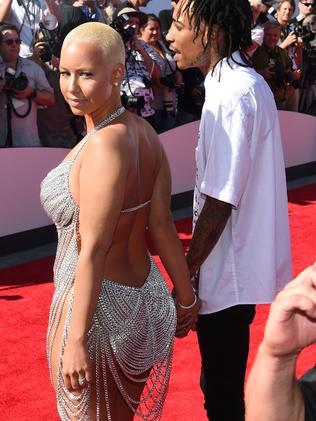 Amber Rose and rapper Wiz Khalifa attend the 2014 MTV Video Music Awards.