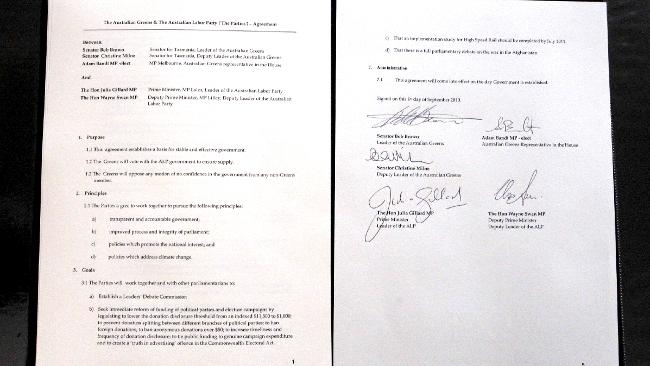 The deal between the Greens and Labor, signed by Julia Gillard, Wayne Swan, Bob Brown, Christine Milne and Adam Bandt / Picture: Ray Strange