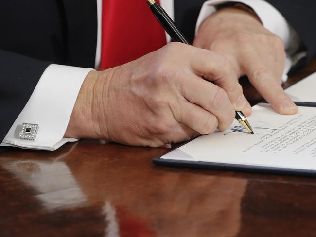 In this Friday, Feb. 3, 2017, file photo President Donald Trump signs an executive order in the Oval Office of the White House in Washington. Picture: AP.