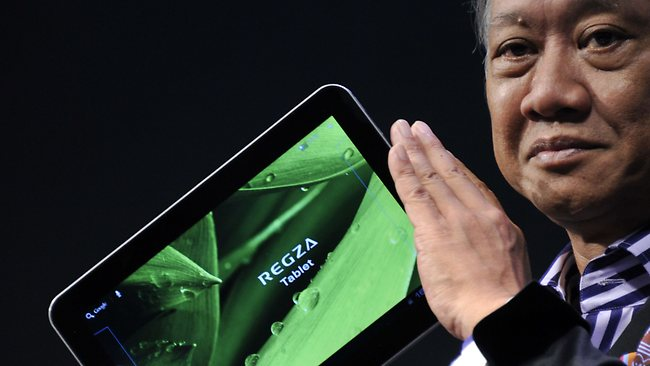 """Toshiba executive Masaaki Osumi displays the world's lightest and slimmest 10.1-inch tablet PC called the """"Regza tablet AT700"""". Picture: AFP"""