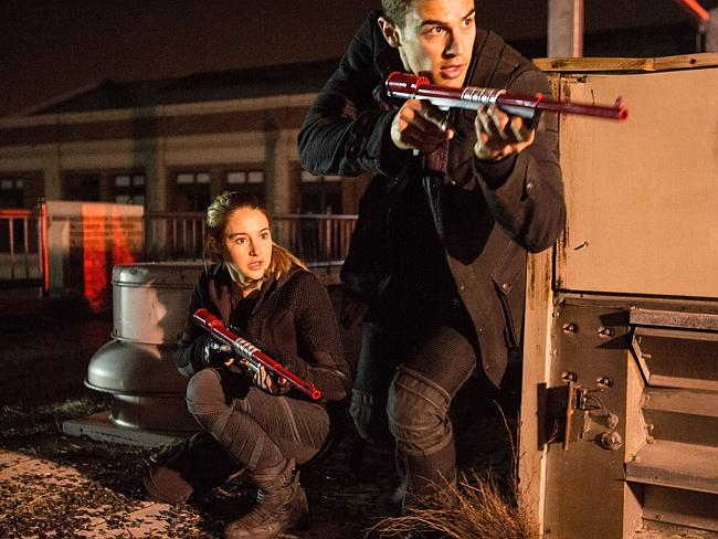Fight for survival ... Shailene Woodley and Theo James in a scene from Divergent.