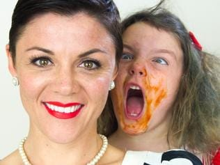 Emelia Rusciano and her daughter Odette with cake on her face. Picture Supplied.