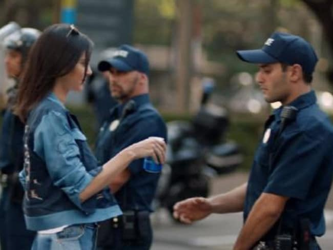 Kendall Jenner handed a cop a Pepsi in the weird ad. Picture: Supplied