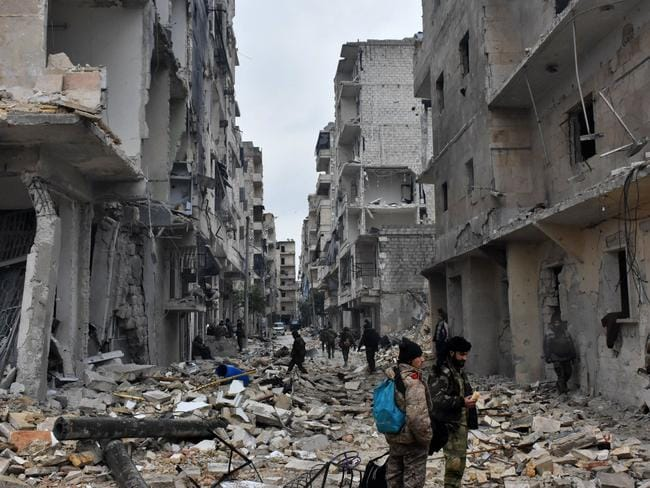 Syrian pro-government forces advance in the Jisr al-Haj neighbourhood during the ongoing military operation to retake remaining rebel-held areas in the northern embattled city of Aleppo. Picture: George Ourfalian/AFP