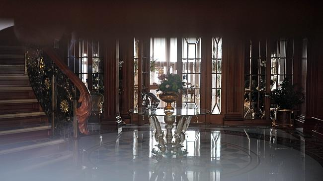 This picture taken through a window shows the interior of the main building of Ukrainian President Viktor Yanukovych's residency near Kiev. Picture: AFP