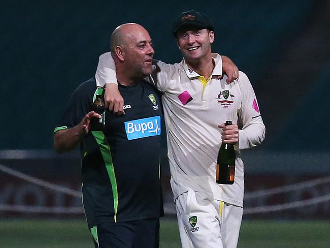 Darren Lehmann and Michael Clarke during happier times — celebrating their 5-0 Ashes sweep last summer.