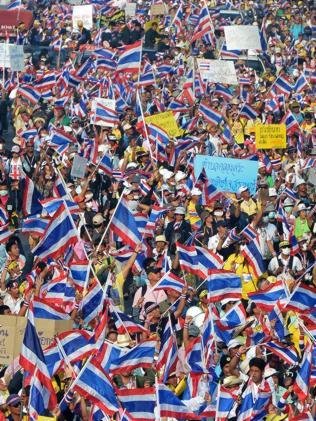 Flag waving ... Anti-government protesters make their feelings known. Pic: Pornchai Kittiwongsakul.