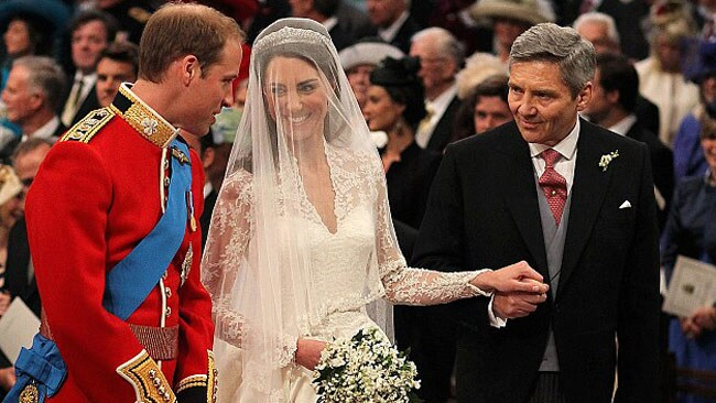 """William silently mouths """"you look so beautiful"""" to Kate as she is given away by her father. Picture: Getty Images"""