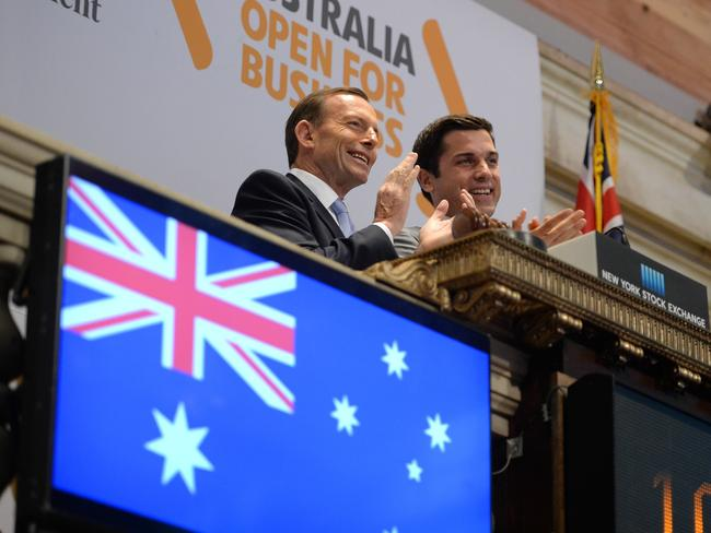 "Tony Abbott tells the Yanks that Australia is ""open for business"" as he literally opens the business of the New York Stock Exchange. Picture: Jake Nowakowski"