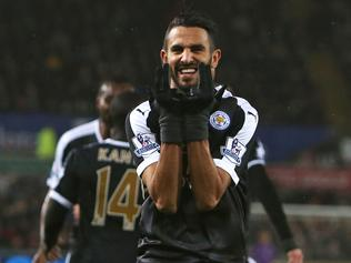 (FILES) This file photo taken on December 05, 2015 shows Leicester City's Algerian midfielder Riyad Mahrez celebrates after scoring his third goal during the English Premier League football match between Swansea City and Leicester City at The Liberty Stadium in Swansea, south Wales on December 5, 2015. Leicester City's Algerian winger Riyad Mahrez on April 24 became the first African player to be named English football's Player of the Year, as voted for by his fellow professionals. / AFP PHOTO / GEOFF CADDICK / RESTRICTED TO EDITORIAL USE. No use with unauthorized audio, video, data, fixture lists, club/league logos or 'live' services. Online in-match use limited to 75 images, no video emulation. No use in betting, games or single club/league/player publications. /