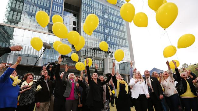 The family of murdered Allison Baden-Clay release yellow balloons, Allison's favourite colour, after her husband Gerard was found guilty / Picture: Jack Tran