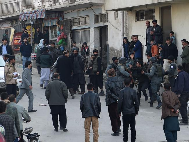 Afghan policemen clash with residents near the Intercontinental Hotel after an attack in Kabul. Picture: AFP