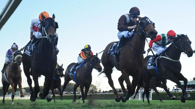 Sweet Idea (centre) ridden by Tommy Berry digs deep to hold off Messene (left) and Rebel Dane in the Missile Stakes. Picture: Simon Bullard