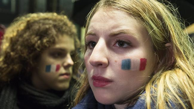People attend a vigil outside the French consulate in Montreal.