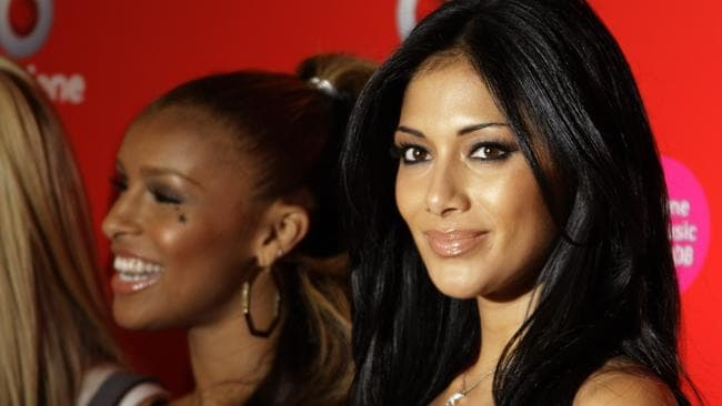 Nicole Scherzinger, pictured here with the other Pussycat Dolls, counting down the minutes until she can go solo.