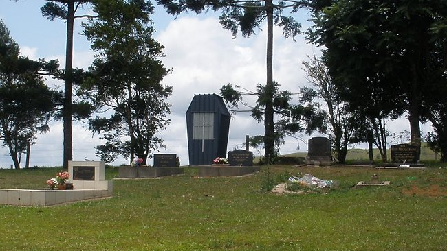 Residents are angry at a coffin-shaped toilet in the Millaa Millaa cemetery.