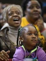 <p>Supporters listen to Obama as he addresses a campaign rally. Picture: Chip Somodevilla/Getty Images/AFP</p>