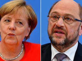 (FILES) This file photo taken on September 01, 2017 shows a combination of file pictures (COMBO) with German Chancellor Angela Merkel, also leader of the conservative Christian Democratic Union (CDU) party (L, on August 29, 2017 in Berlin) and Martin Schulz, leader of Germany's social democratic SPD party and candidate for Chancellor (on June 27, 2017 in Berlin). / AFP PHOTO / Tobias SCHWARZ