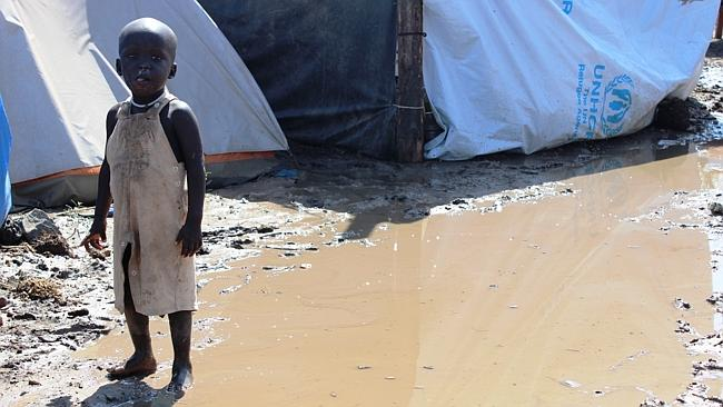 A child clothed with what's available after a storm washes through Tomping displacement c
