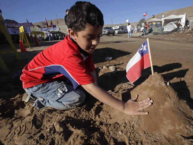 Byron Avalos, son of trapped miner Florencio Avalos, builds a representation of the mine where his father was trapped outside the collapsed San Jose mine in Copiapo, Chile in 2010. Picture: AP