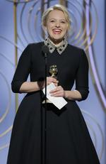 Elisabeth Moss accepts the award for Best Performance by an Actress in a Television Series Drama for The Handmaids Tale speaks onstage during the 75th Annual Golden Globe Awards. Picture: Getty