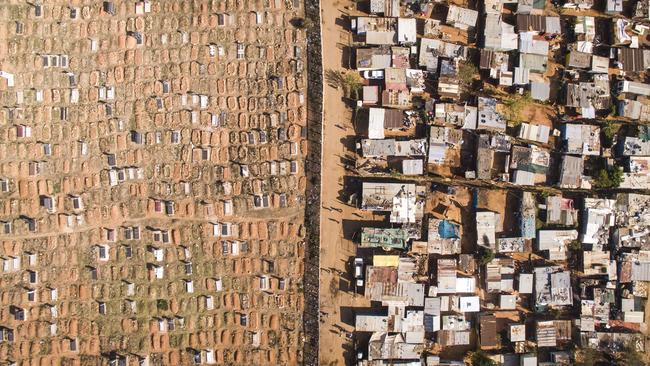 More than 30,000 people live in about 8500 shacks in Vusimuzi, settled between a cemetery and two wealthier suburbs in Johannesburg. Picture: Johnny Miller/Millefoto/Rex Shutterstock